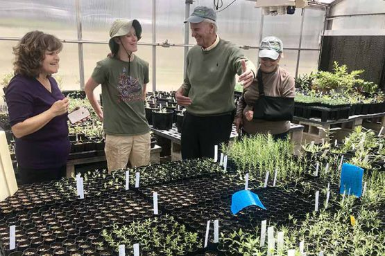 Dr. and Mrs. Lucking visiting NAU greenhouse