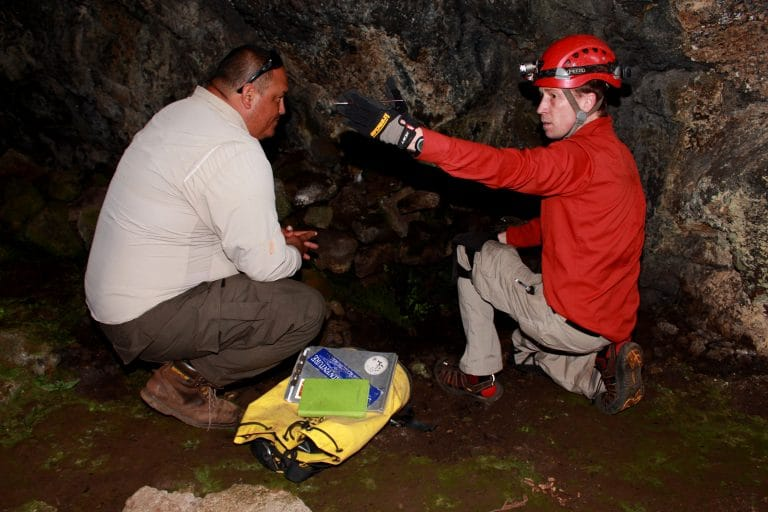 Jut Wynne and colleague in cave